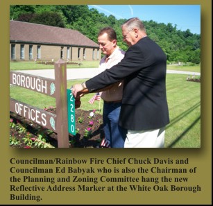 Councilman/Rainbow Fire Chief Chuck Davis and Councilman Ed Babyak who is also the Chairman of the Planning and Zoning Committee hang the new Reflective Address Marker at the White Oak Borough Building.